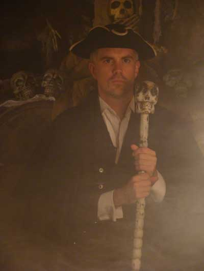 Dale Jarvis storyteller in costume in the Catacombs. width=
