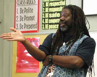 Micheal D. McCarty Storyteller speaking to a High-school about the Art of Storytelling and Literacy.