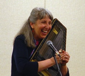 Angela Lloyd Storyteller playing the Washboard
